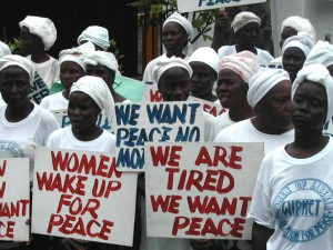 Liberian women demonstrate at the American Embassy in Monrovia at the height of the civil war, 2003.